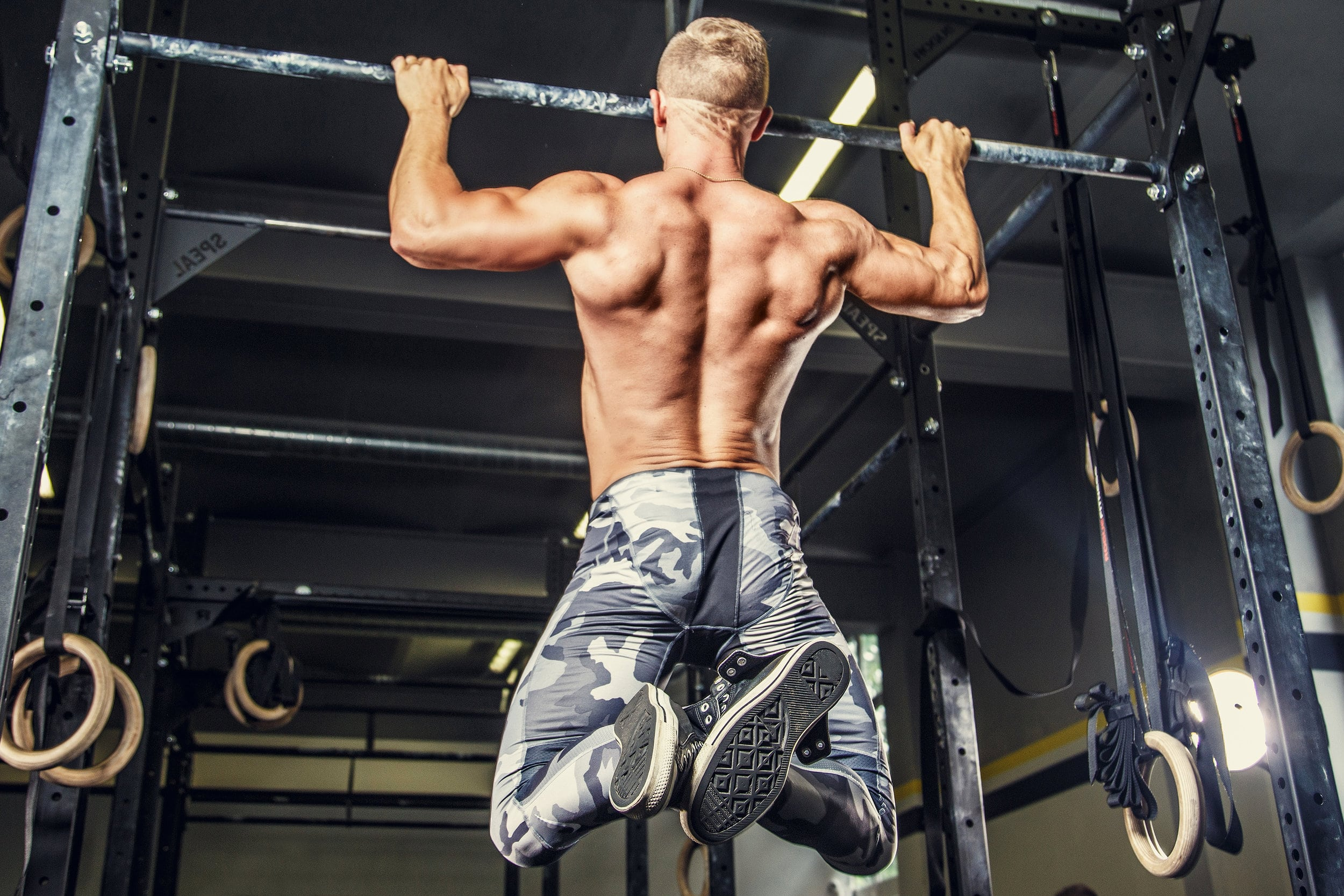 How to perform pull-ups with a wide grip on the crossbar